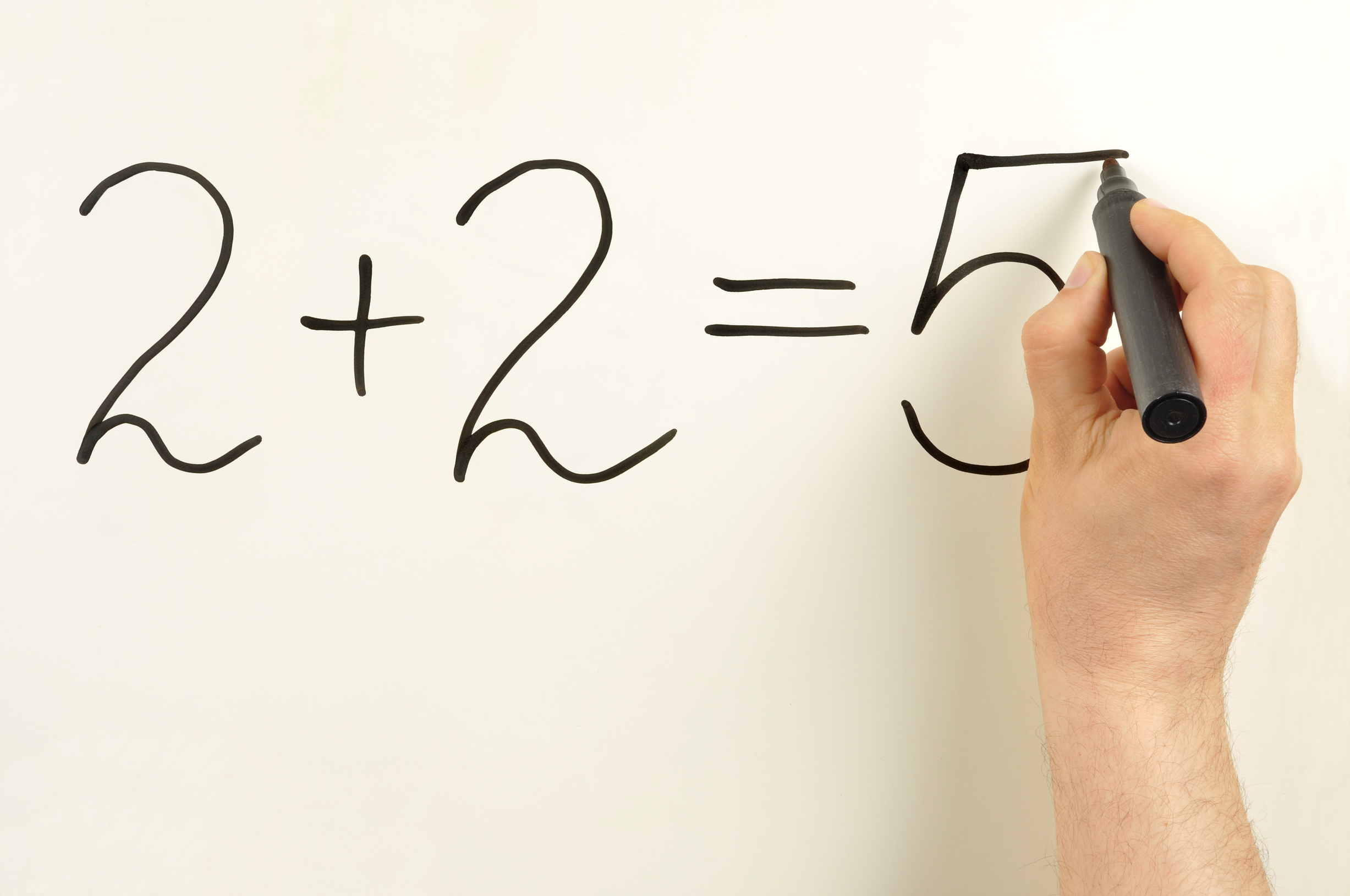 2+2=5 formula written on a board